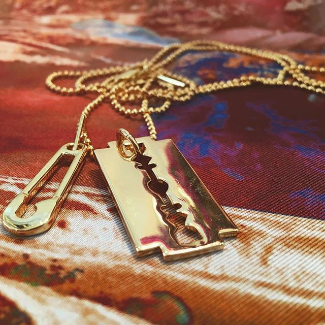 McQ Alexander McQueen razor blade and safety pin pendant necklace in gold at Pour Tous 🏻 Shop our insta- Link in our Bio #10867
