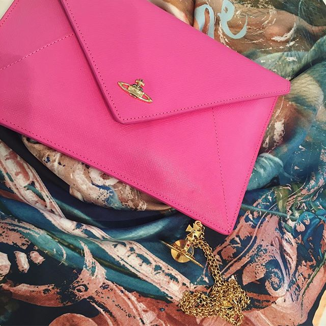 Christmas gift ideas for her, Envelope clutch $240, Vivienne and Andreas scarf in powder pink $270, Orb Pendant $390, all Vivienne Westwood at Pour Tous 🍾Shop our insta- Link in our Bio #10779
