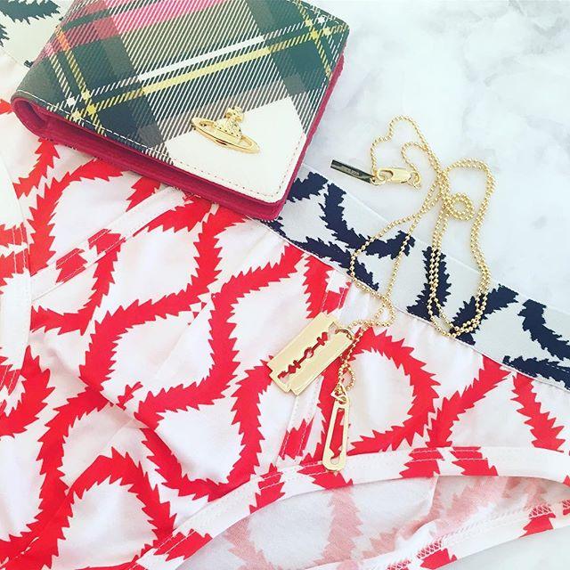 Christmas gift ideas for him, Vivienne Westwood Derby Wallet New Exhibition Tartan $210, Vivienne Westwood Mens Squiggle Print Brief $100, McQ Alexander McQueen Razor Blade Pendant $140 🏻Shop our insta- Link in our Bio #10875