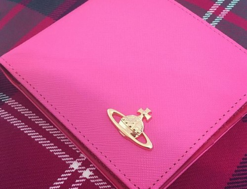 Add some colour to your accessories with this divine Vivienne Westwood candy pink wallet at Pour Tous